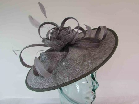 hatinator with sinamay flower and loops in mercury silver