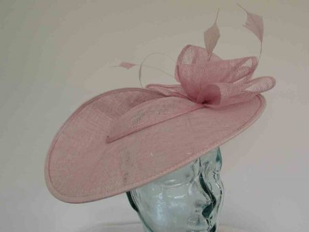 Large hatinator with sinamay loops in wild rose