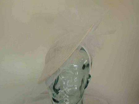 Hatinator with crin brim and bow detail in white