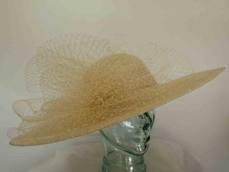 Large circular hat with netting in metallic champagne