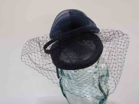 Pillbox fascinator with birdcage netting in navy