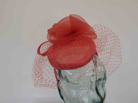 Pillbox fascinator with birdcage netting in tangerine