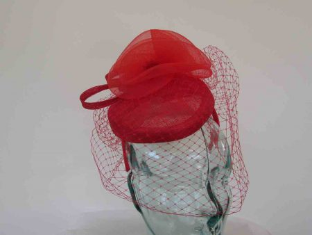 Pillbox fascinator with birdcage netting in red tulip