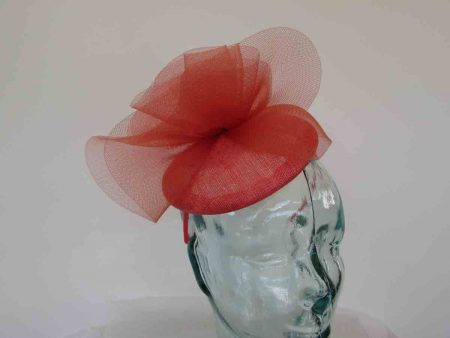 Pillbox fascinator with crin twist in tangerine
