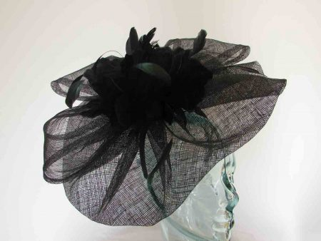 Wavy sinama fascinator with large feathered flower in black