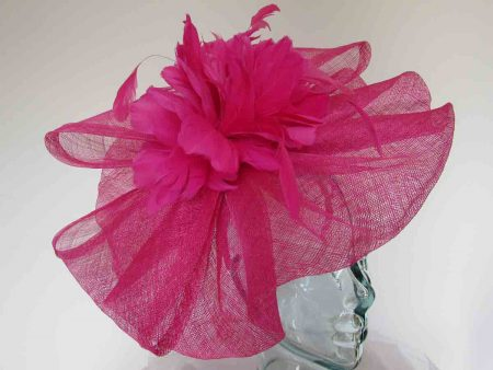 Wavy sinamay fascinator with large feathered flower in calypso