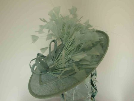 Circular hatinator with dramatic feather detail in bermuda