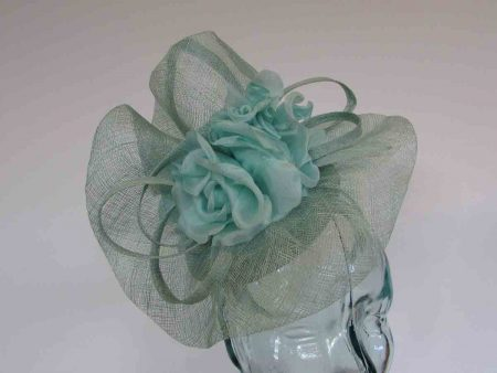 Pillbox base fascinator with flower detail in bermuda mint