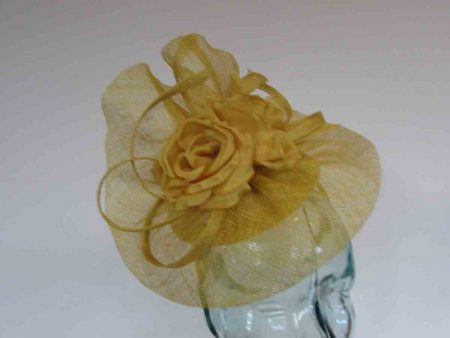Pillbox base fascinator with flower detail in daffodil yellow