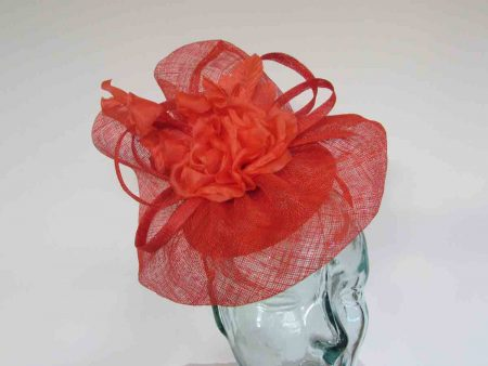 Pillbox base fascinator with flower detail in vermilion