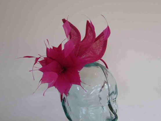 Triple sinamay leaves fascinator in magenta