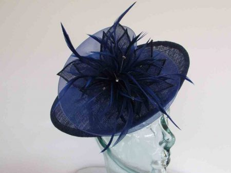Small hatinator with chiffon flower in marine blue