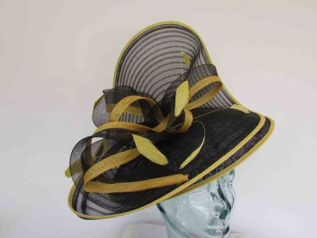 Large wave of black crin fascinator with yellow trim