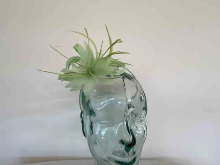 Satin fascinator with feathers flower in light green