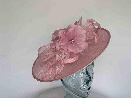 Sinamay hatinator with double feathered flower in wild rose