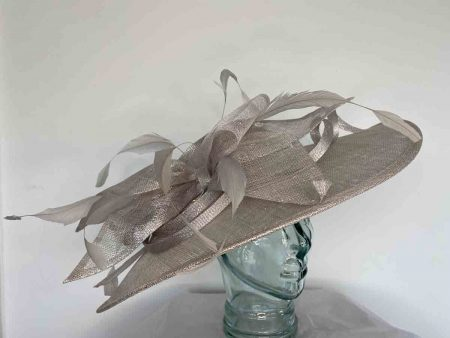 Oval hatinator with sinamay bow in metallic quartz