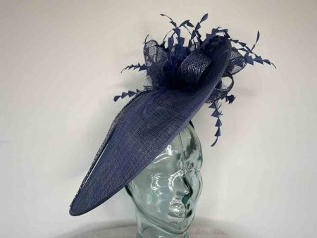 Large hatinator with diamante shaped feathers in navy with silver lurex