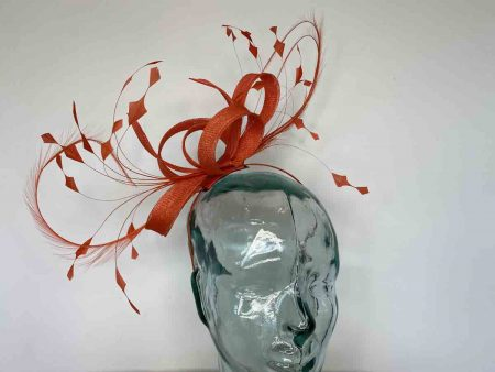 Sinamay looped fascinator with curled feathers in tangerine