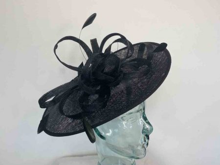 hatinator with sinamay flower and loops in black