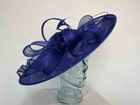 Large hatinator with sinamay loops in cobalt blue