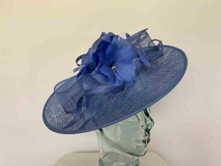 Sinamay hatinator with double feathered flower in cornflower