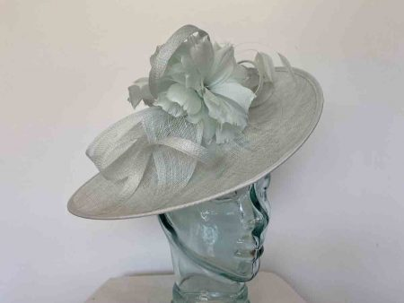 Sinamay hatinator with double feathered flower in mint sorber