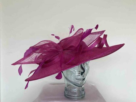 Oval hatinator with sinamay bow in fucshia pink