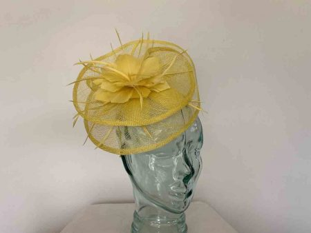 Sinamay fascinator with feahered flower in bright yellow