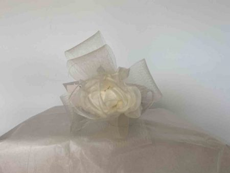Flower  fascinator with crin loops in ivory