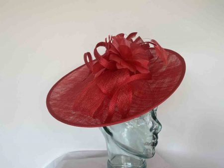 Sinamay hatinator with double feathered flower in red