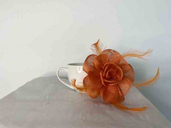 Sinamay flower fascinator in orange