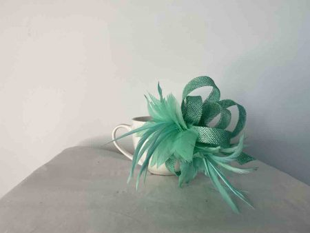 Sinamay fascinator in bright mint