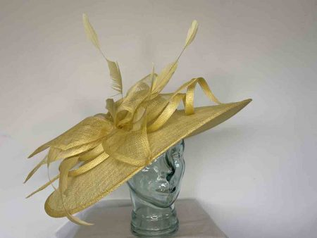 Oval hatinator with sinamay bow in lemon