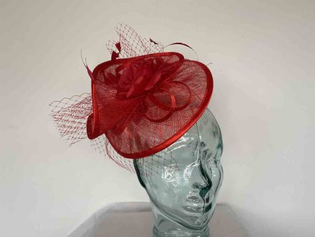 Twisted sinamay fascinator in poppy red
