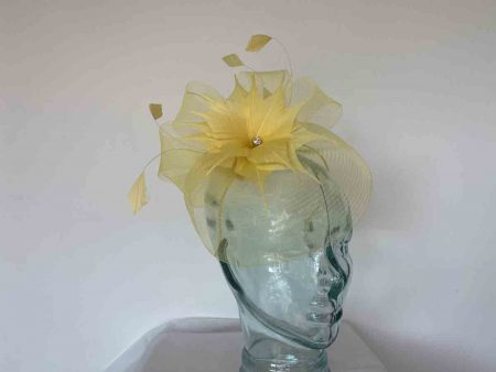 Crin fascinator with feathered flower in bright yellow