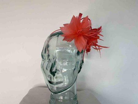 Satin fascinator with feathers flower in coral