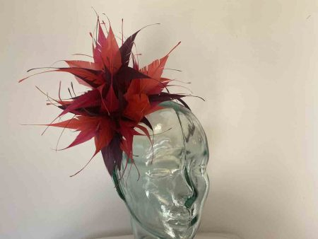 Feathered fascinator in damson, strawberry and fuschia