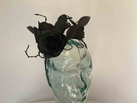 Material rose and leaf fascinator in black