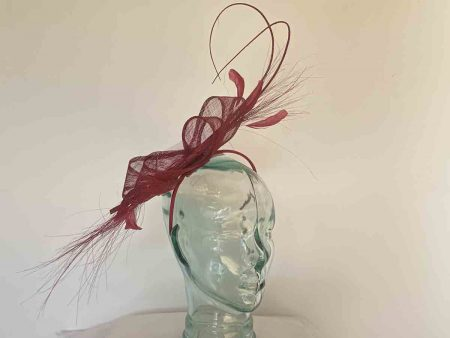 Sinamay fascinator with dramatic feather in burgandy