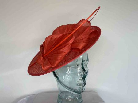 Sinamay hatinator with single quill in vermillion